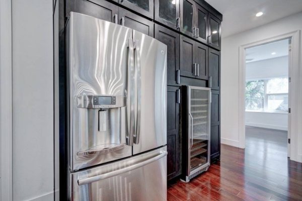 Charcoal kitchen cabinets with white caesarstone 7